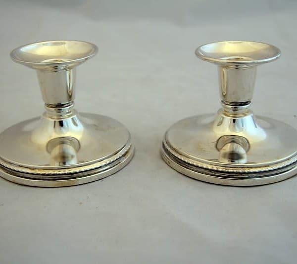 Серебряные парные маленькие подсвечники
